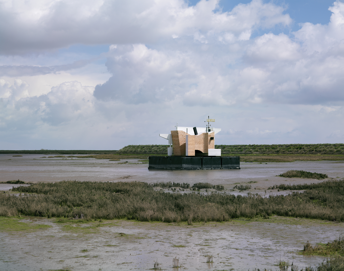 Photo of Flood House on the Thames Estuary, partly cloudy skies